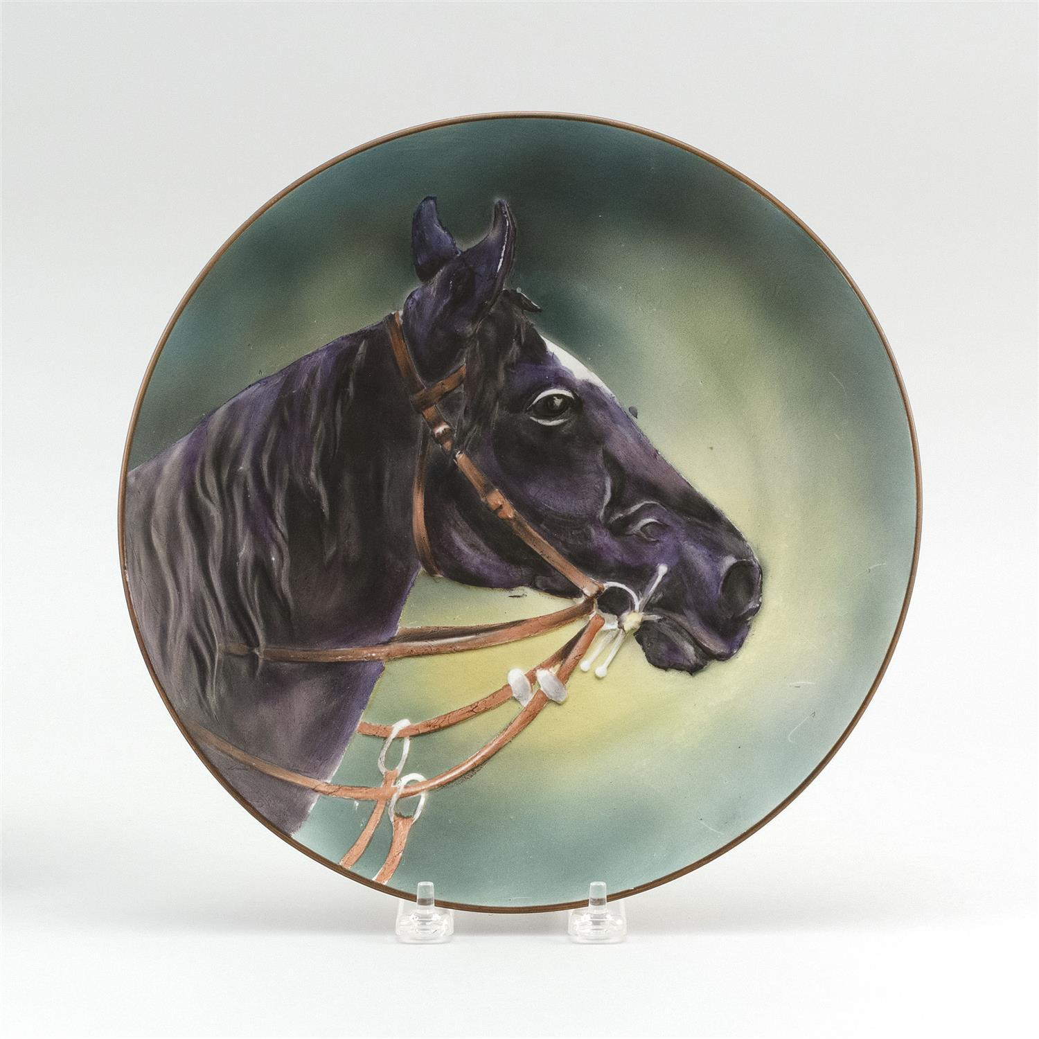 "MOLDED NIPPON PORCELAIN PLAQUE With blown out design of a horse. Van Patten #47 mark on base. Diameter 10.5""."