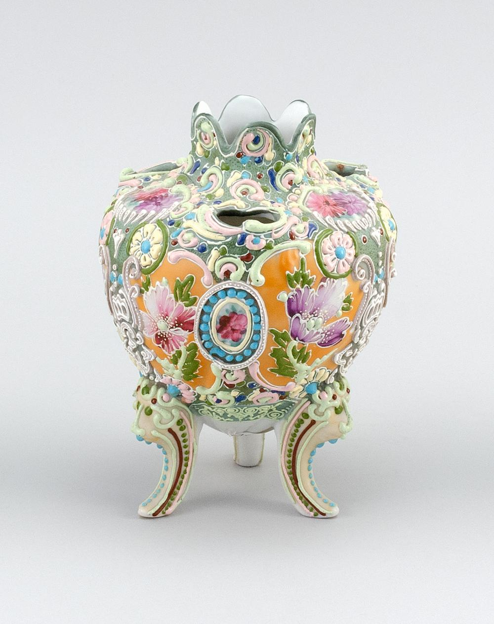 """MORIAGE NIPPON PORCELAIN NARCISSUS VASE Ovoid, with tripod base and floral design. Height 7""""."""