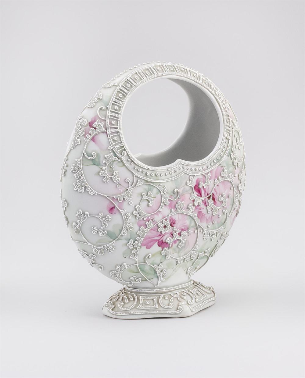 MORIAGE NIPPON PORCELAIN VASE In basket form, with moriage vines on a pink floral-patterned ground. Height 8.75