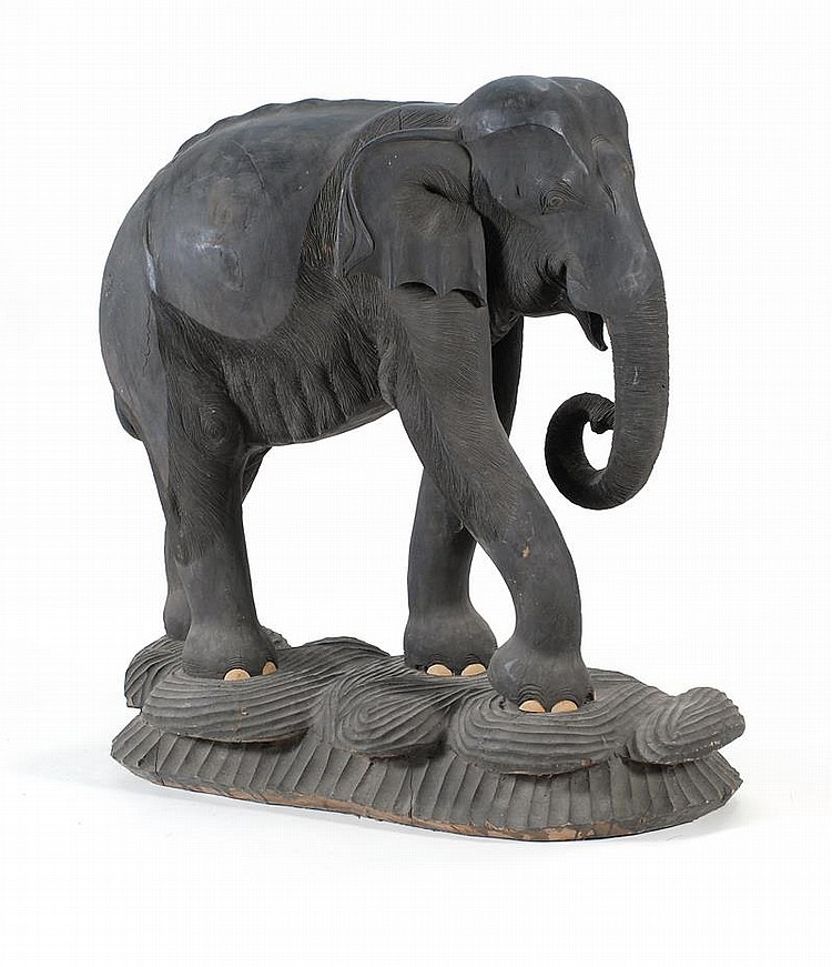 "LARGE NICELY CARVED EBONIZED-WOOD ELEPHANT On a carved wood base. Height 39"". Length 38"". Width 16""."