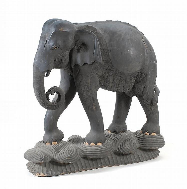 LARGE NICELY CARVED EBONIZED-WOOD ELEPHANT On a carved wood base. Height 39