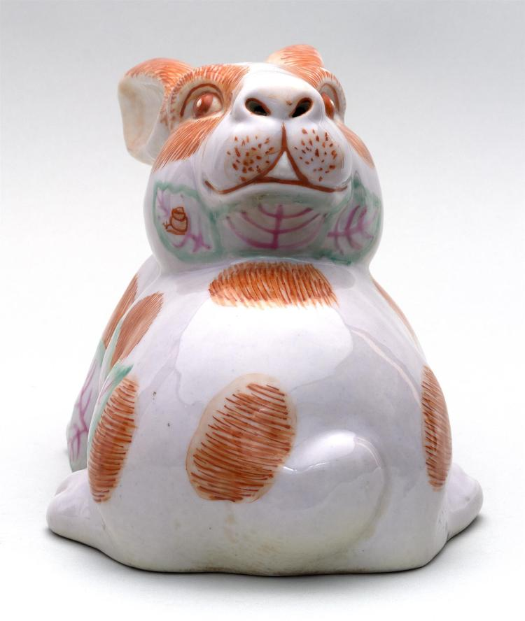 CHINESE POLYCHROME PORCELAIN FIGURE OF A RABBIT In a crouched position with its head facing backwards. Tobacco leaf pattern on an or...