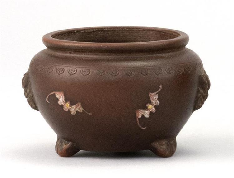 CHINESE ENAMELED YIXING POTTERY FOOTED JAR In ovoid form with tripod base and lion's-head handles. Polychrome bat and peach design....