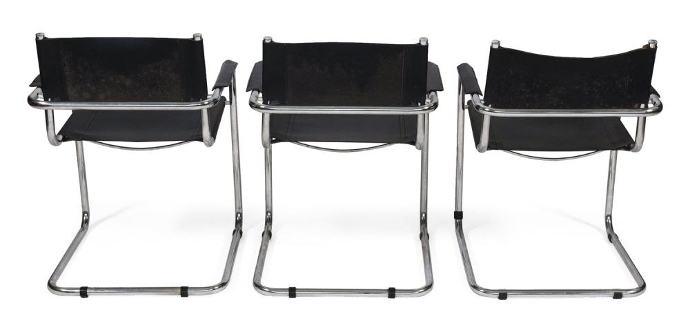 THREE ITALIAN MODERNIST CHROME AND VEGAN LEATHER ARMCHAIRS With black sling backs, seats and padded arm rests. Labeled
