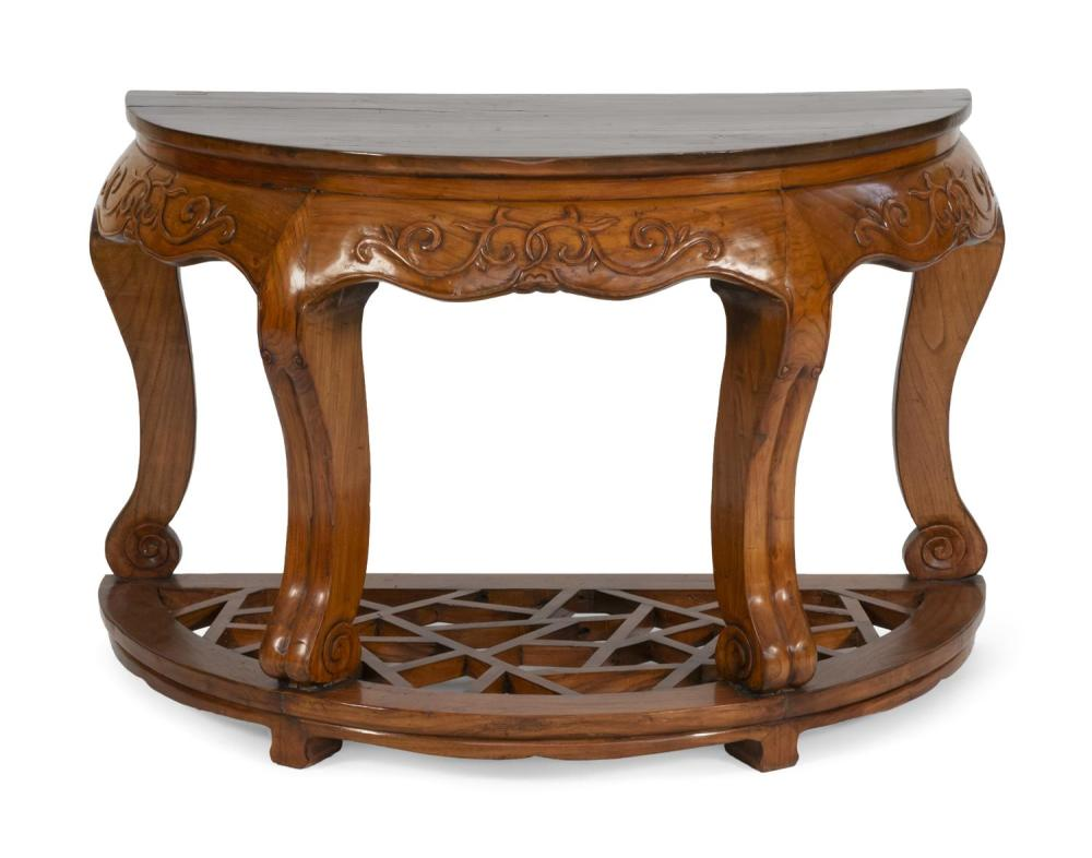 """CHINESE DEMILUNE CONSOLE TABLE Shaped apron with raised foliate carving. Openwork lattice stretcher. Height 33"""". Width 24"""". Depth 24""""."""