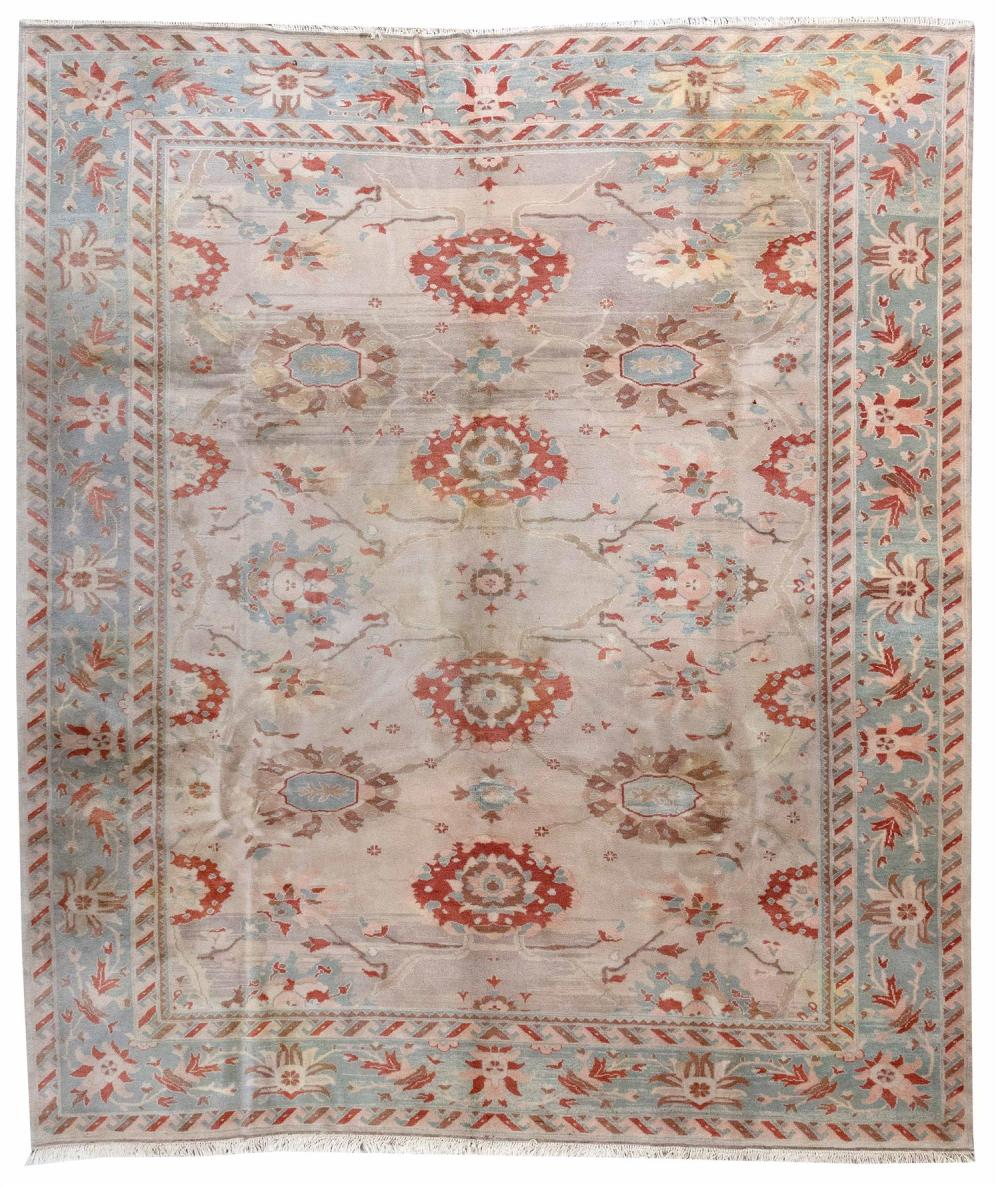 """ORIENTAL RUG: SULTANABAD DESIGN 9'3"""" x 10'11"""" Abrashed light gray field with traditional red, light blue, light brown and pink grace."""