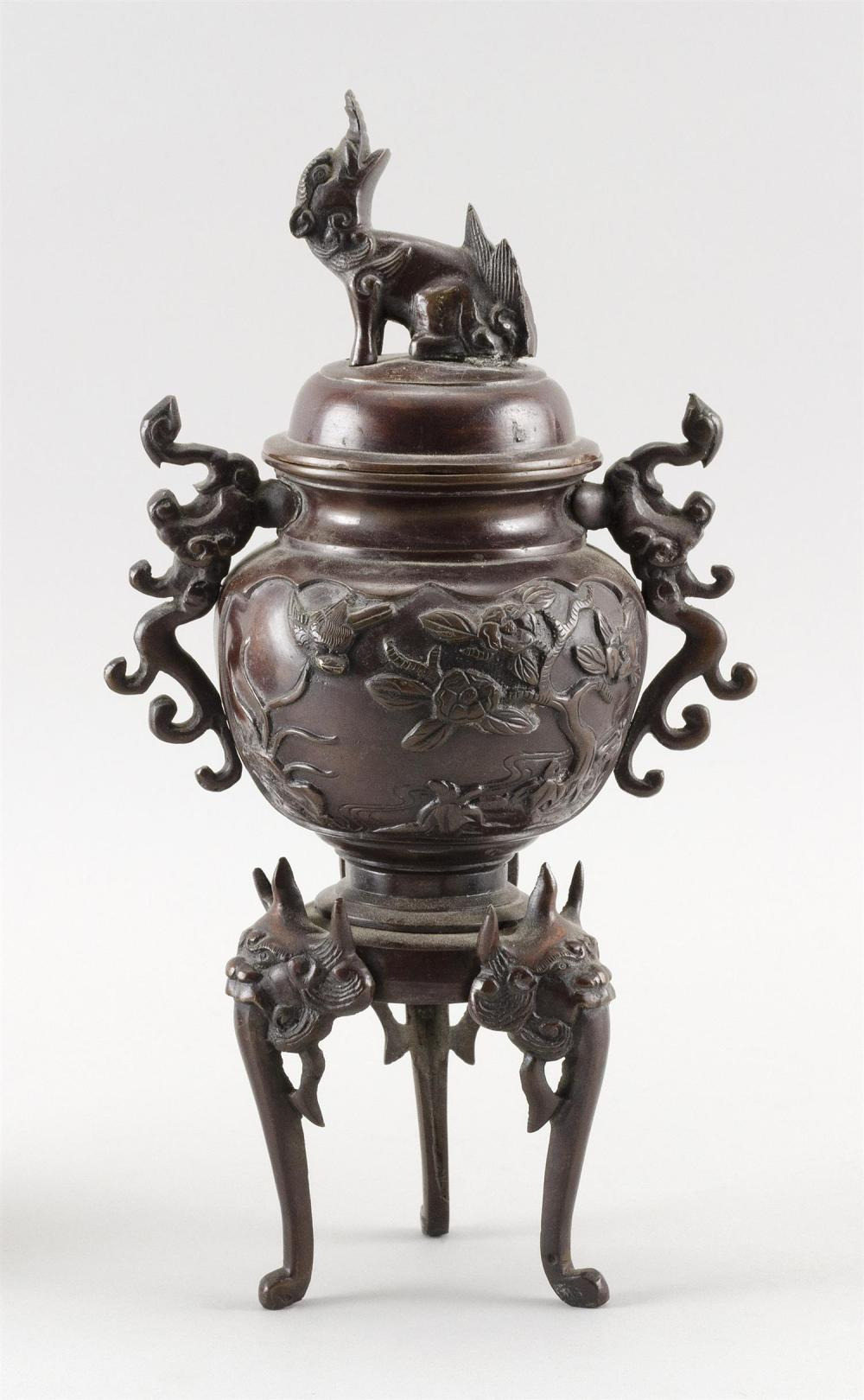 """JAPANESE BRONZE INCENSE BURNER In urn form with three legs. Foo dog finial on cover. Height 11""""."""