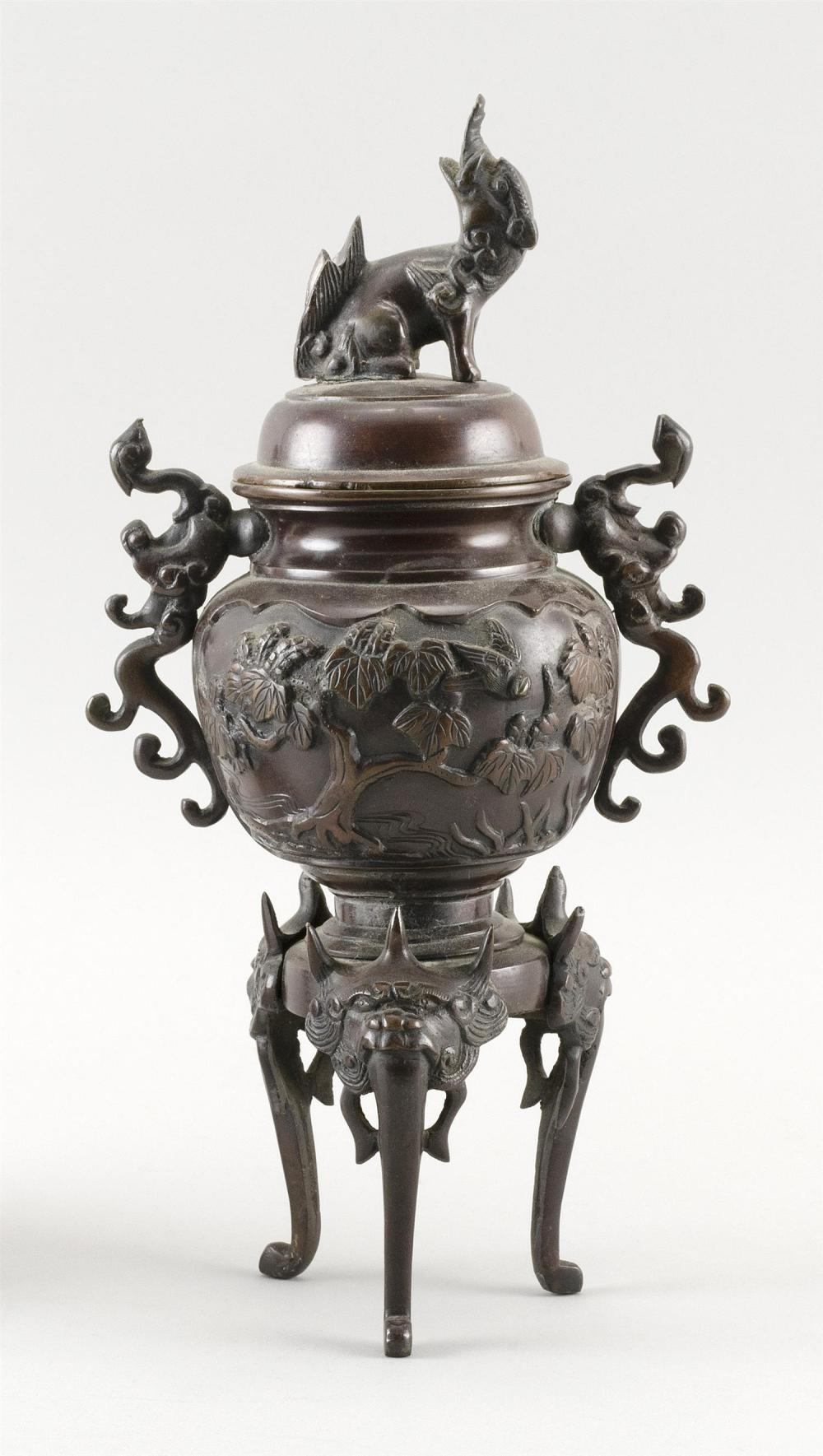 JAPANESE BRONZE INCENSE BURNER In urn form with three legs. Foo dog finial on cover. Height 11