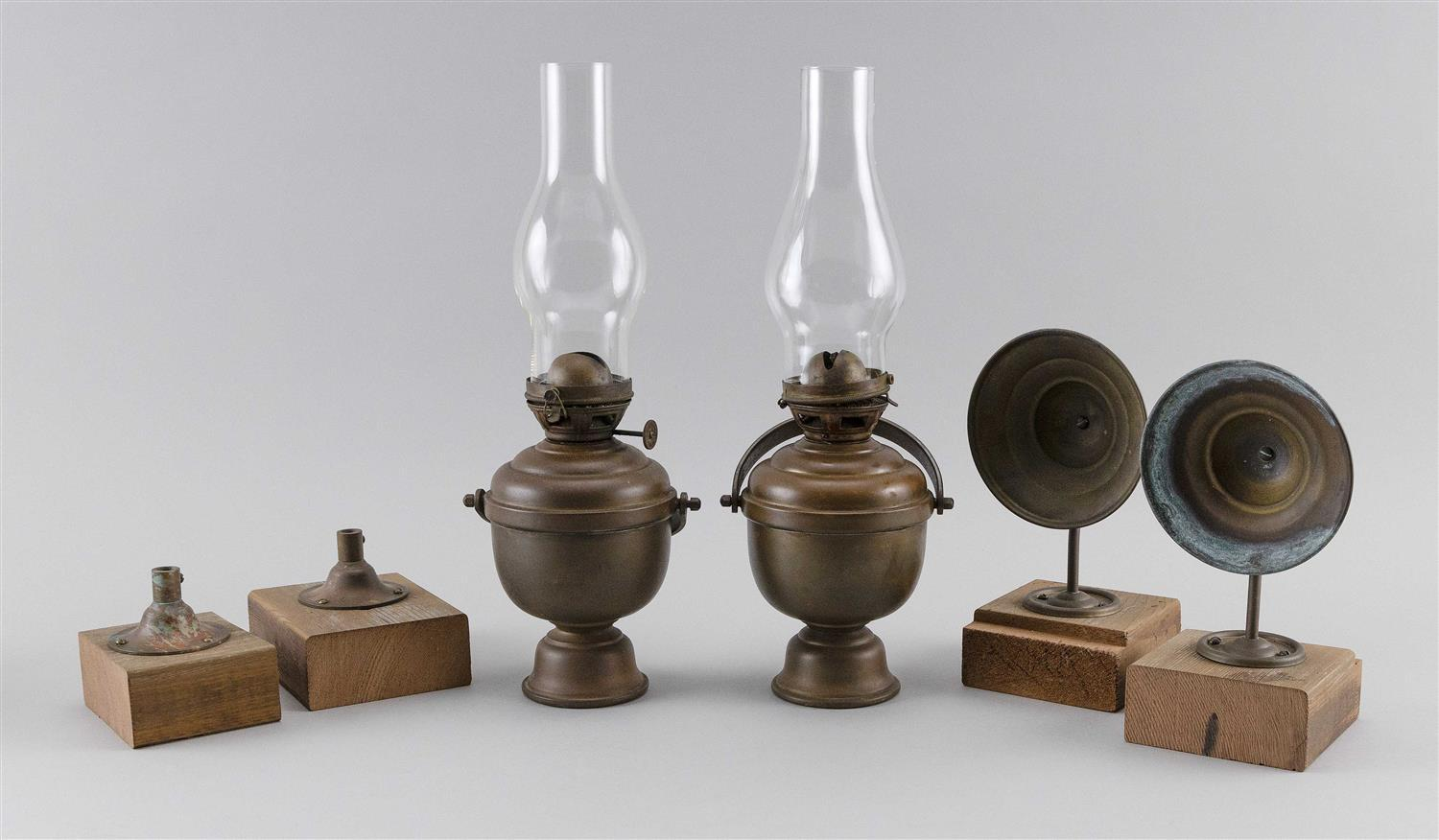 """PAIR OF PERKO GIMBALED BRASS YACHT LAMPS Complete with globes and smoke bells. Lamp heights 7""""."""