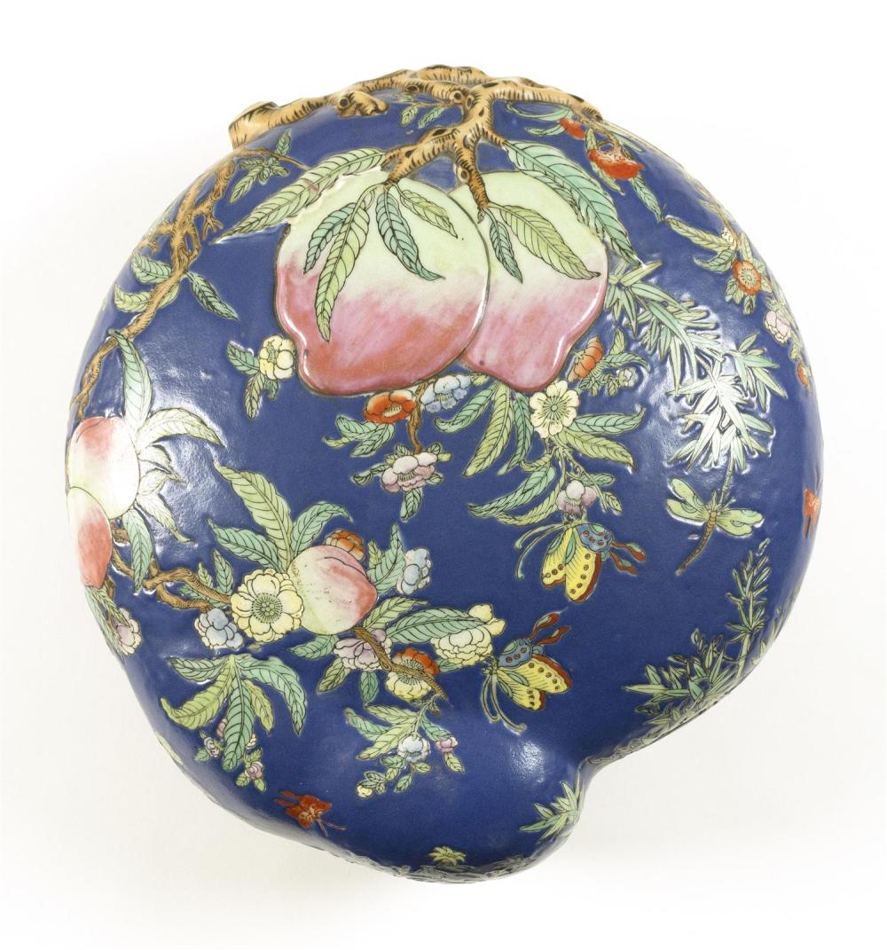 CHINESE FAMILLE ROSE PORCELAIN PEACH-FORM COVERED BOX Raised peach branch and butterfly decoration on a powder blue ground. Four-cha...