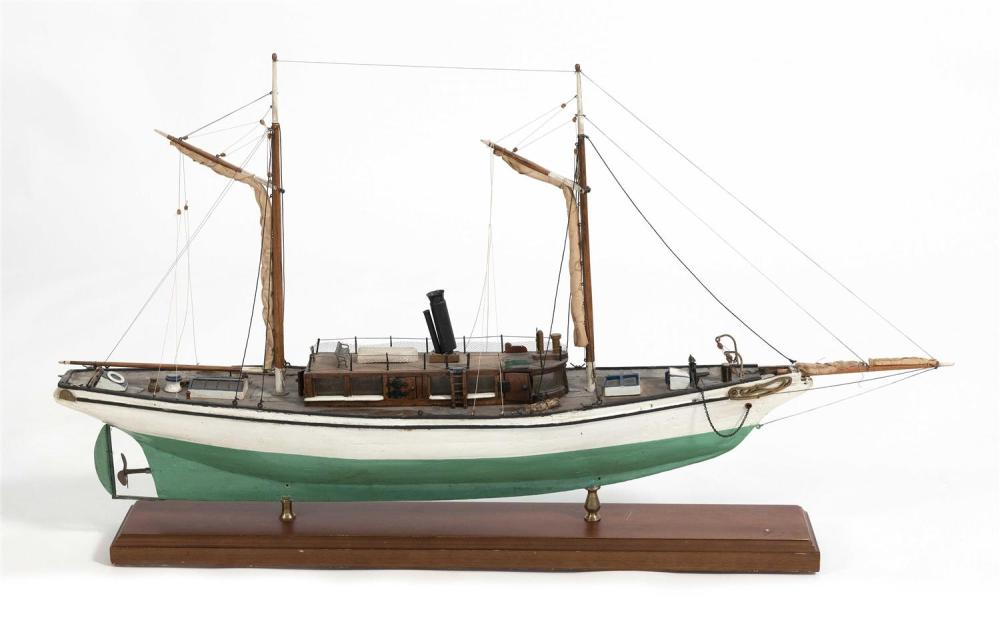 FOLK ART MODEL OF A STEAM/SAIL YACHT Hull built up from the solid with painted green bottom and white topsides. Mahogany veneer deck...