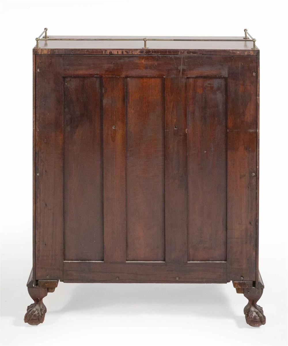 CHIPPENDALE-STYLE SLANT-LID DESK In mahogany. Top with brass gallery. Fitted interior. Claw & ball feet. Height 41