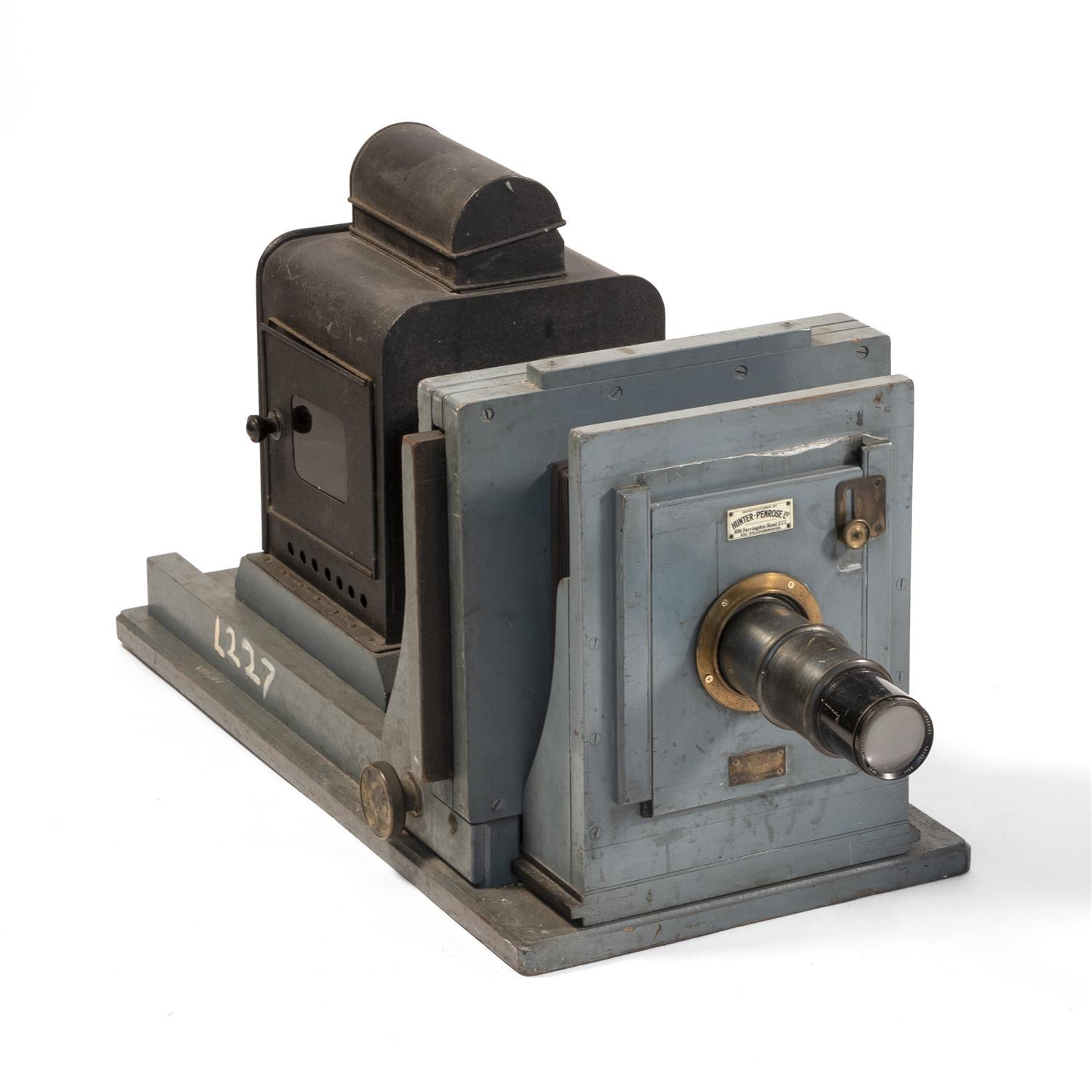PROJECTOR Manufactured by Hunter-Penrose LTD. Aldis-Butcher projection lens. Housed in a blue/gray-painted wood and metal body. Heig...
