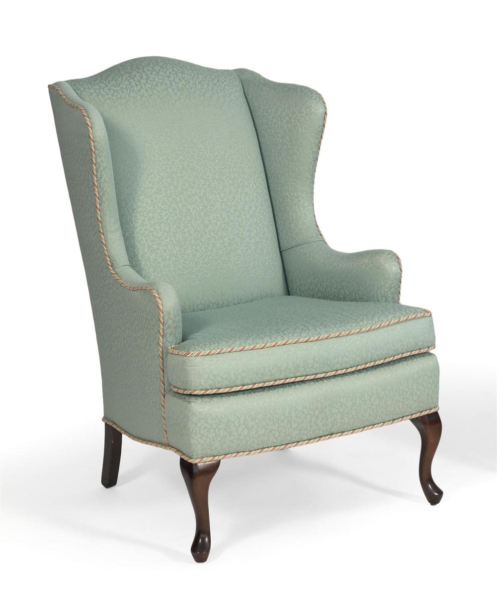 """QUEEN ANNE-STYLE WING CHAIR Mahogany legs. Green upholstery. Back height 41.5"""". Seat height 20""""."""