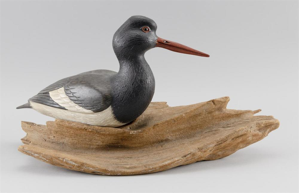 ARMAND CARNEY DECORATIVE CARVING OF AN OYSTER CATCHER Signed and dated 1971 on a brass plaque on the bottom of a driftwood base. Hei...