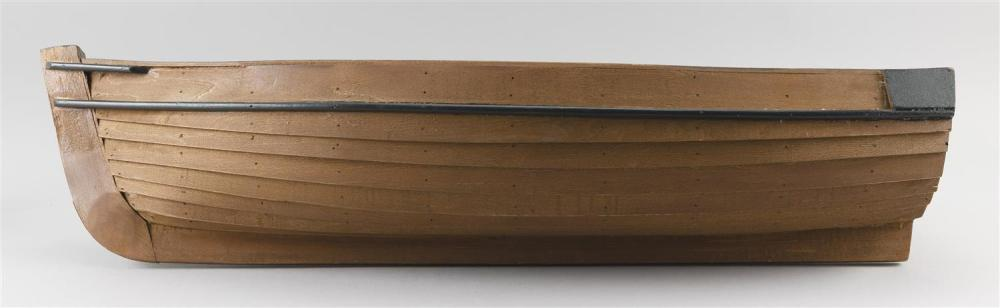 WOODEN MODEL OF A SKIFF Painted brown and green. Includes two oars. Height 5.5