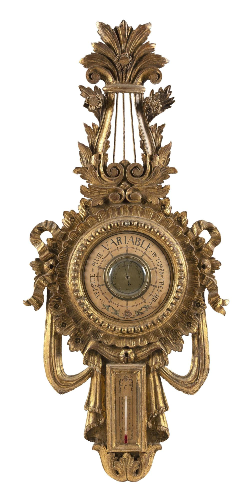 """DECORATIVE WALL BAROMETER In lyre and ribbon form. Gilt painted decoration. Height 39"""". Width 17""""."""