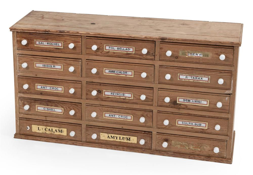 "PINE APOTHECARY CHEST Fitted with 15 drawers with milk glass pulls. Many drawers with traces of medicine labels. Height 24"". Width 4..."