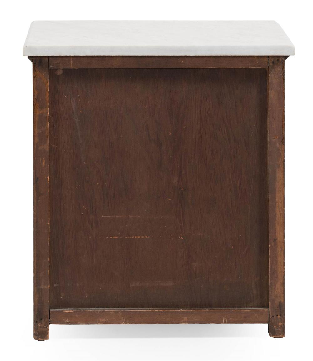 CHILD-SIZE THREE-DRAWER CHEST In pine, with newer white marble top. Paneled sides. Shaped flat bracket base. Drawers with circular b...