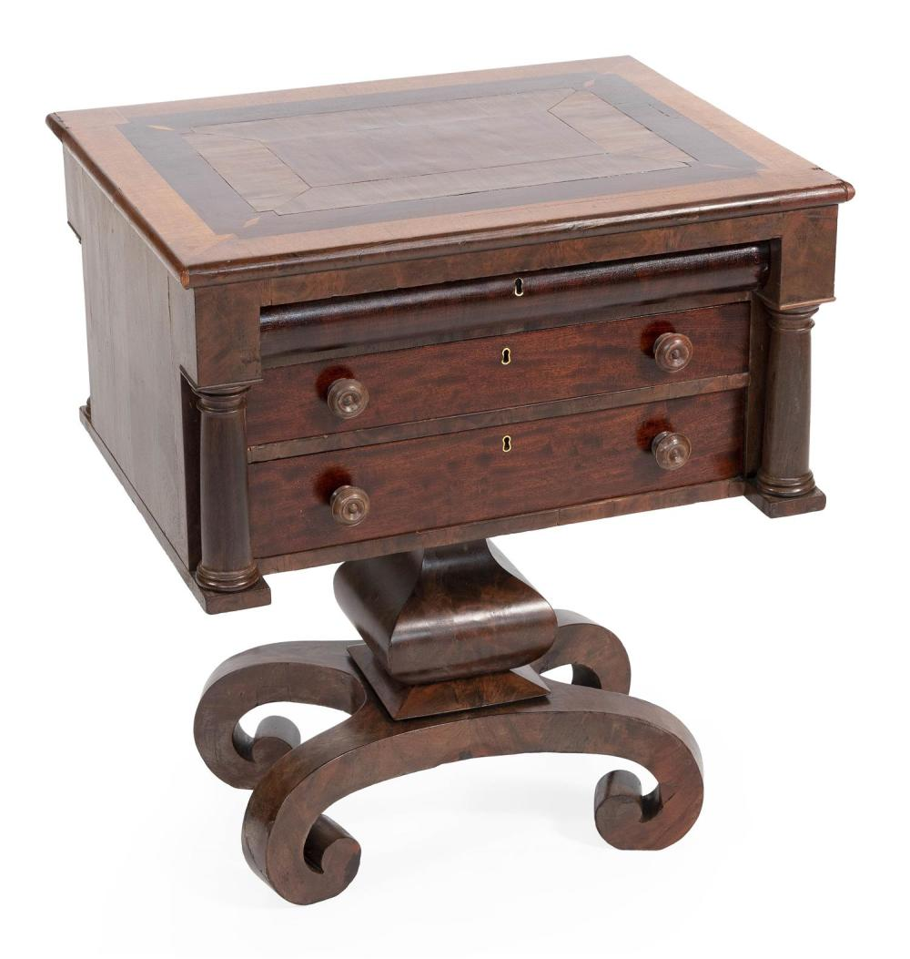 EMPIRE THREE-DRAWER STAND In mahogany and mahogany veneer. Drawers with circular wooden pulls. Three-quarter columns at sides of cas...