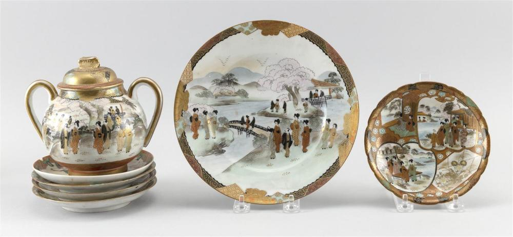 """SEVEN PIECES OF JAPANESE KUTANI PORCELAIN A two-handled covered sugar bowl, height 6"""", one 8.5"""" plate and four 6"""" plates, all with m..."""