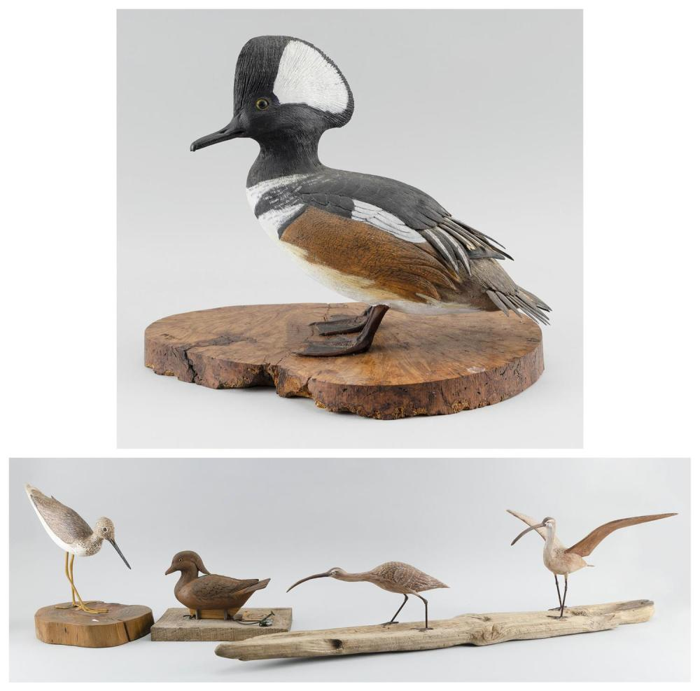 """FOUR DECORATIVE BIRD CARVINGS A hooded merganser, height 11.5"""", a standing yellowlegs, height 10"""", a wood duck signed on base """"D. Si..."""