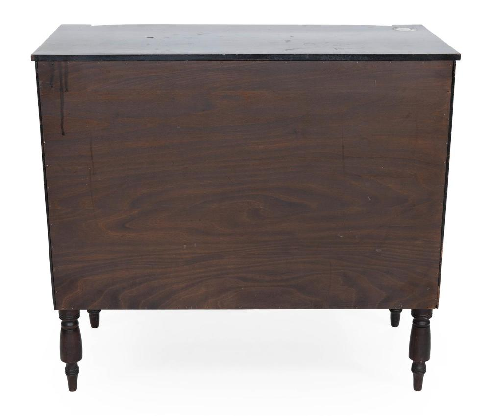 SHERATON BUREAU In cherry with bird's-eye maple veneer drawer fronts. Shaped top over four graduated full-width drawers flanked by r..