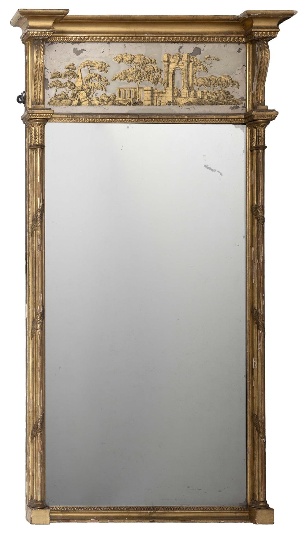 """FEDERAL-STYLE PIER MIRROR Reverse-painted upper tablet depicts classical ruins. Gilt frame. Height 50"""". Width 29.25""""."""