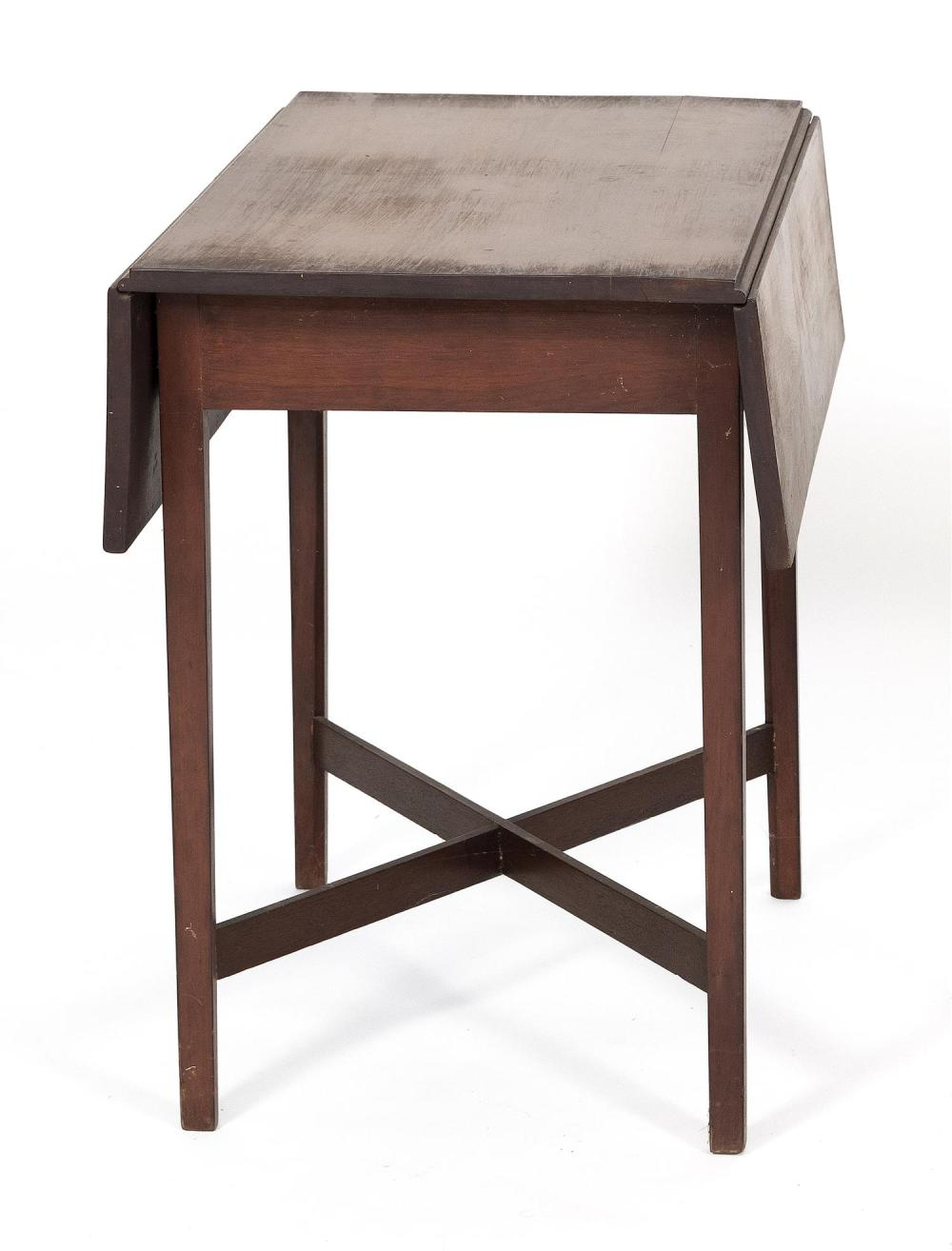 PEMBROKE TABLE In mahogany. Drawer with a circular brass pull. Square tapered legs joined with a cross-stretcher. Height 28.5