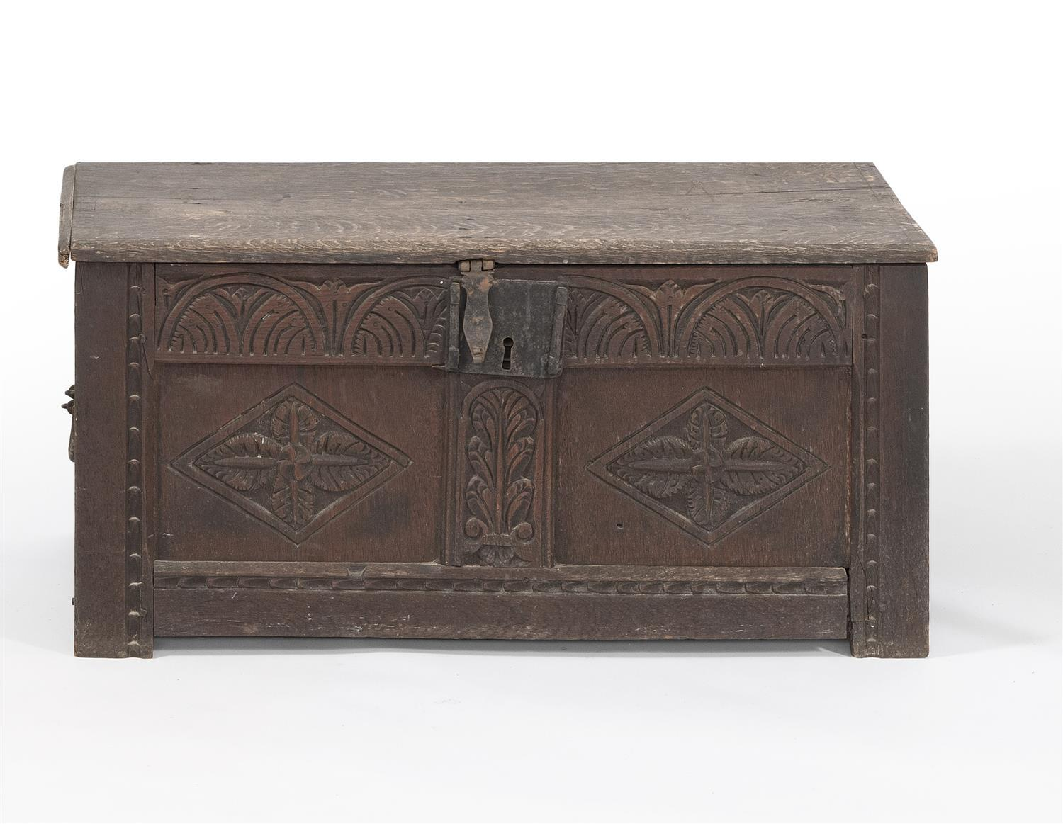 """LIFT-TOP BLANKET BOX In oak, with iron strap hinges. Carved paneled front. Height 16.5"""". Width 35.25"""". Depth 17""""."""