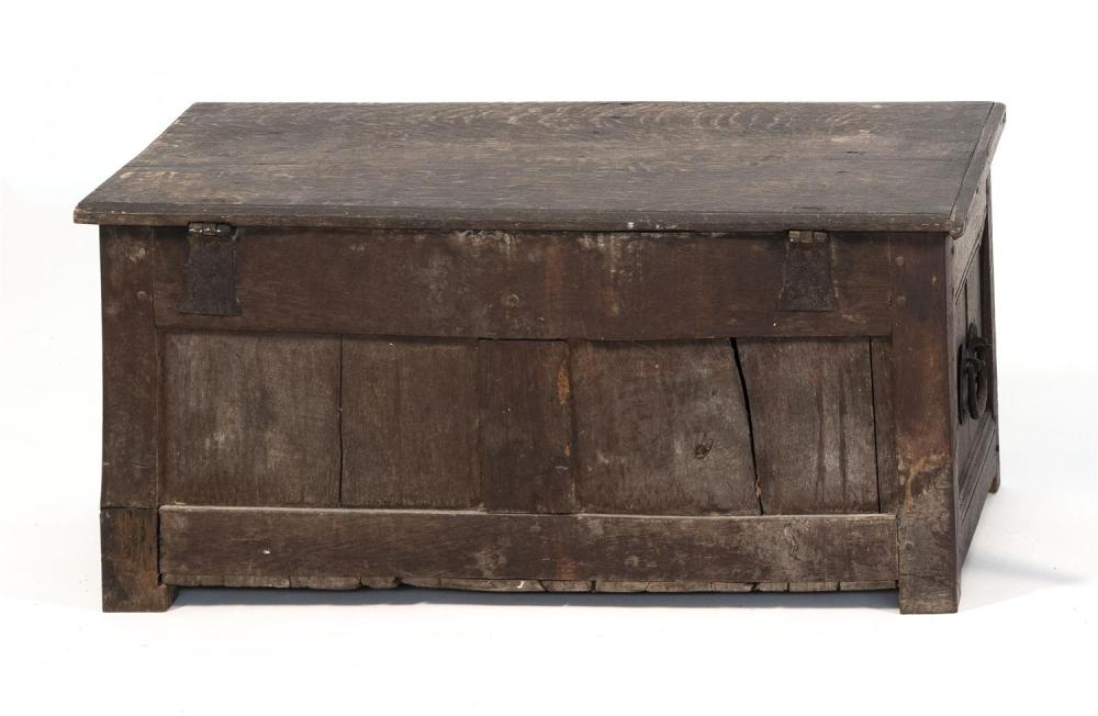 LIFT-TOP BLANKET BOX In oak, with iron strap hinges. Carved paneled front. Height 16.5