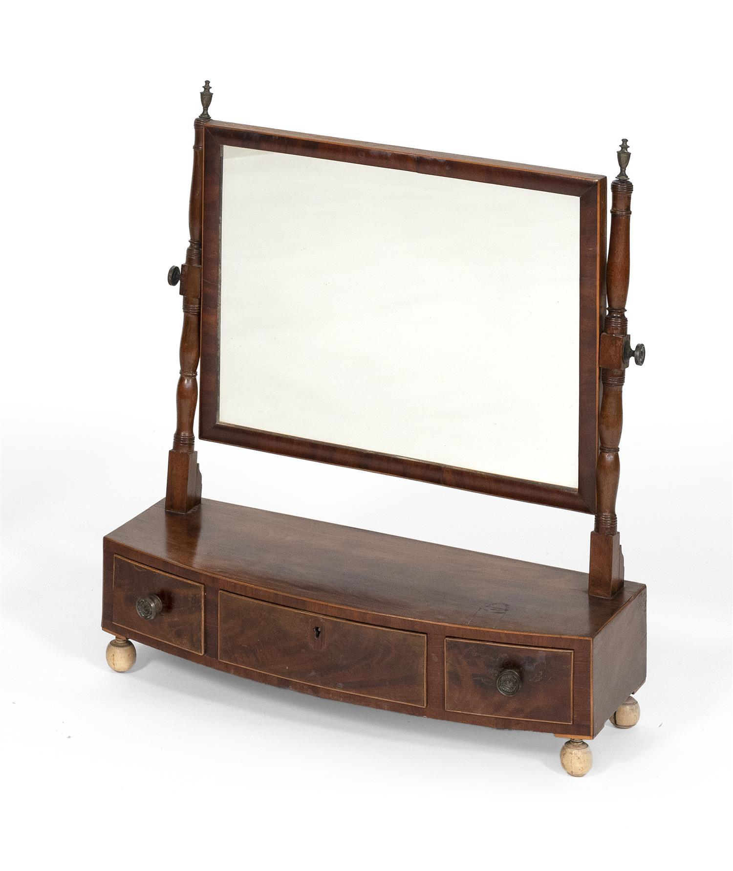 GEORGE III SHAVING MIRROR In mahogany and mahogany veneer with string inlay along perimeter. Rectangular mirror with turned supports...