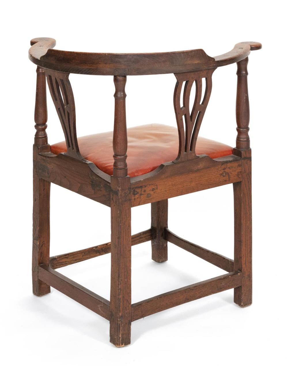 GEORGE II CORNER CHAIR In yew wood, with nice patina. Back with vertical pierced splats. Scrolled arms. Slip seat. Block legs joined...