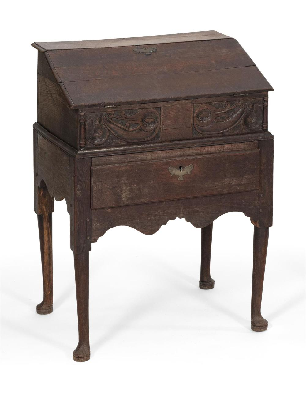 GEORGE II DESK ON FRAME In oak. Desk with slant lid that opens to serve as a writing surface and conceals three interior drawers. Fr...