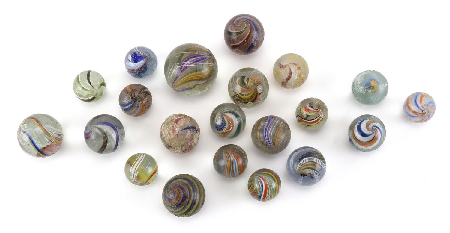 TWENTY ONIONSKIN AND OTHER GLASS MARBLES Various shapes and patterns.