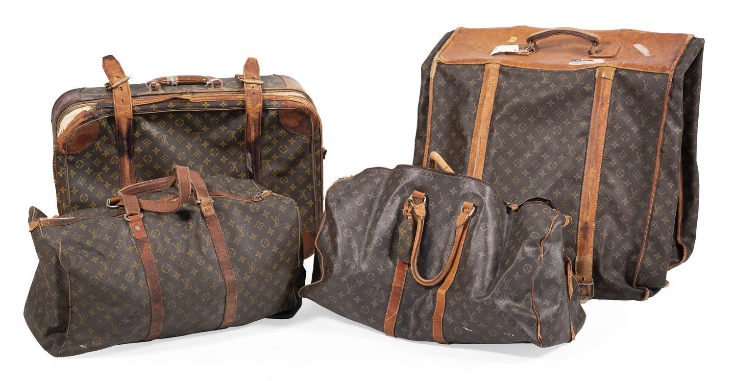 """FOUR PIECES OF LOUIS VUITTON LUGGAGE Suitcase, garment bag and two soft-sided bags. Lengths from 21"""" to 23""""."""
