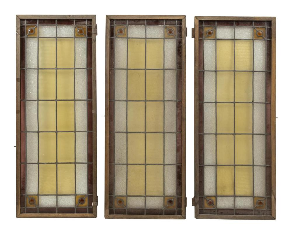 THREE FRENCH LEADED GLASS WINDOW PANELS Each with ten yellow panes surrounded by cracked ice and lavender borders, with amber caboch...