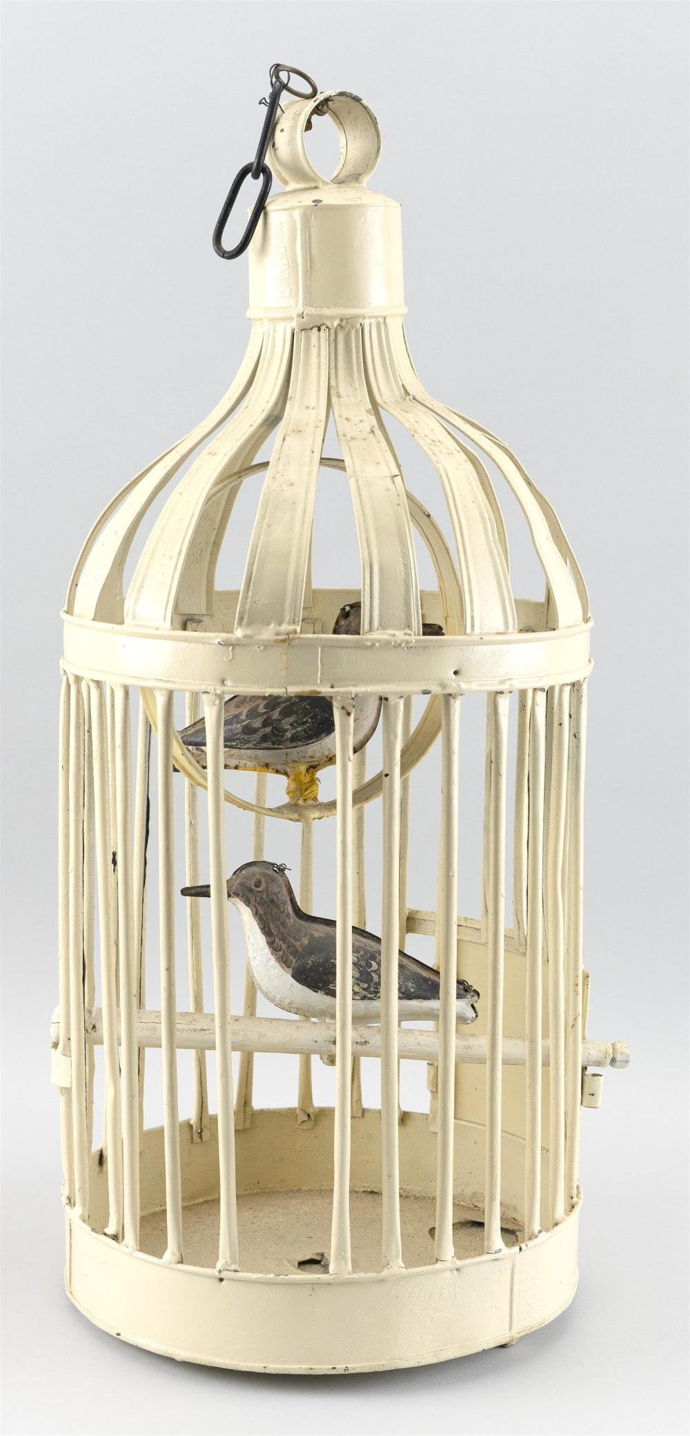 TIN BIRDCAGE CONTAINING TWO TIN SANDERLING DECOYS Circa 1880 decoys in original paint. 20th Century birdcage painted white. Total he...