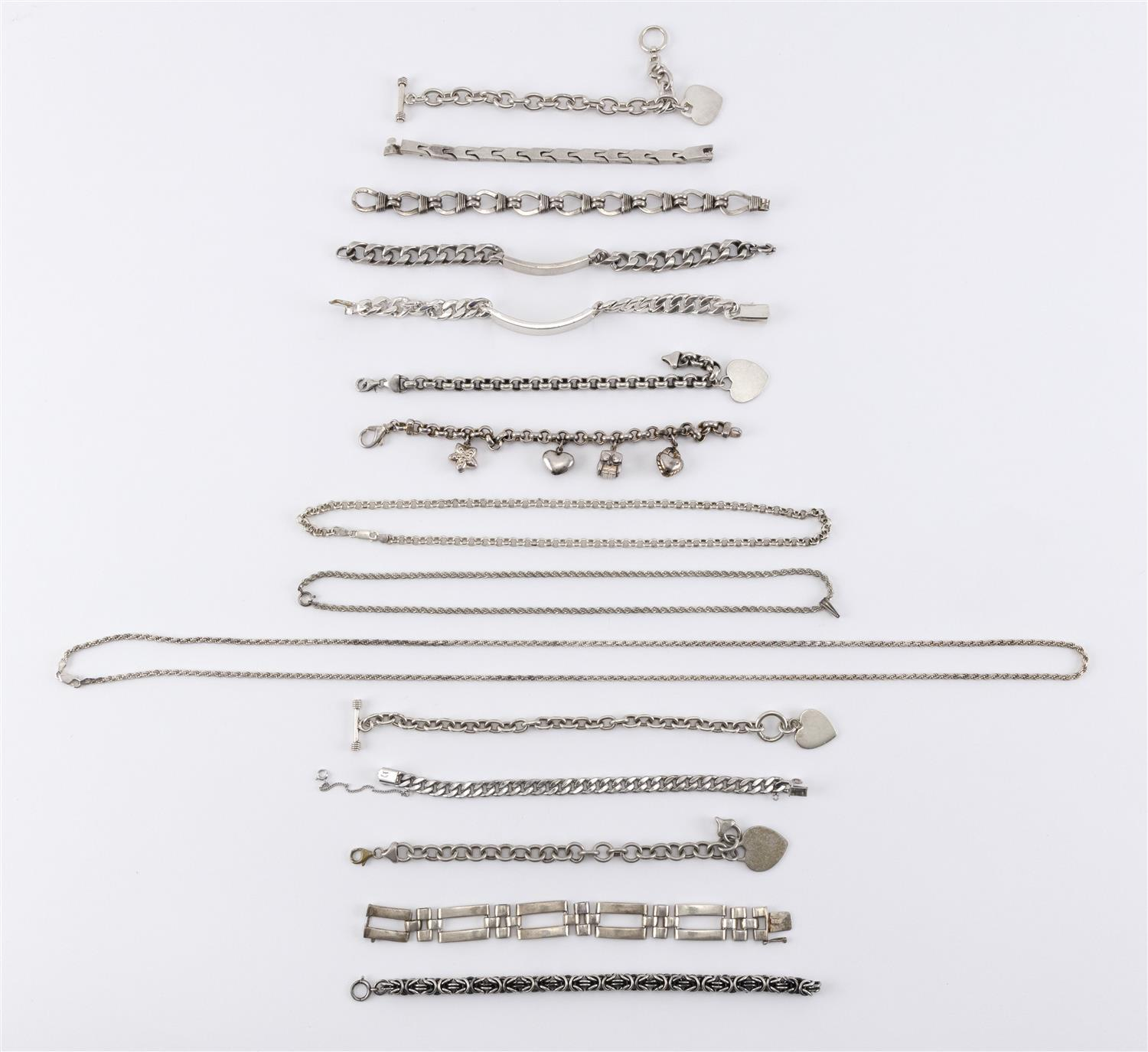 FIFTEEN PIECES OF SILVER JEWELRY Three rope or chain necklaces and twelve link bracelets, many in Tiffany style. Some marked sterlin...