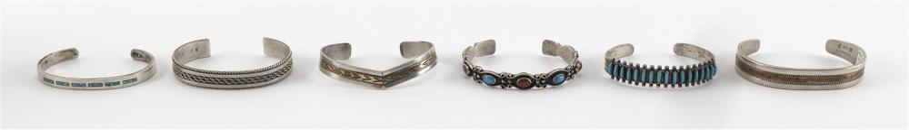 SIX ASSORTED NATIVE AMERICAN INDIAN STERLING SILVER CUFF BRACELETS Three with turquoise embellishments, and two with chased and engr...