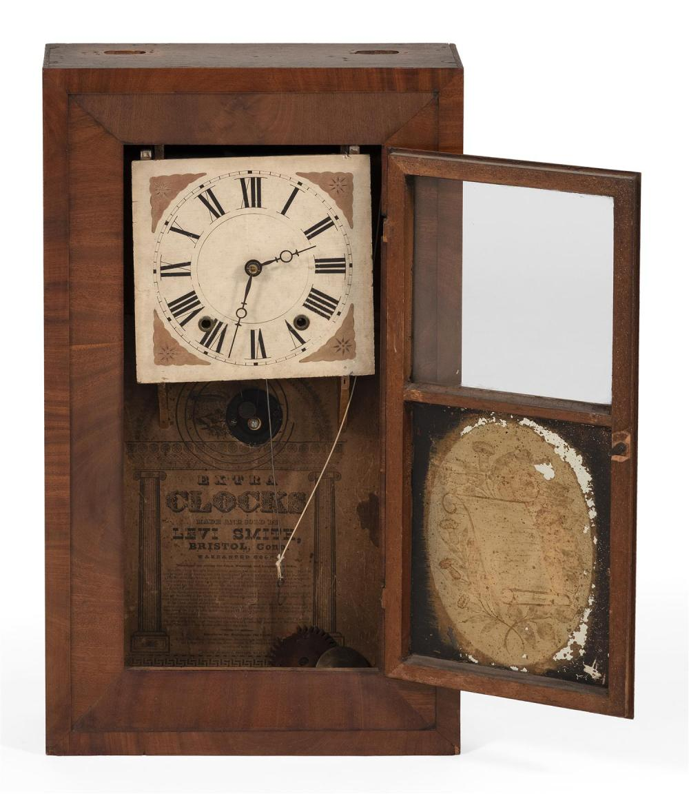 LEVI SMITH CASED MANTEL CLOCK Mahogany veneer case. Reverse-painted glass depicts flowers. Height 26.5