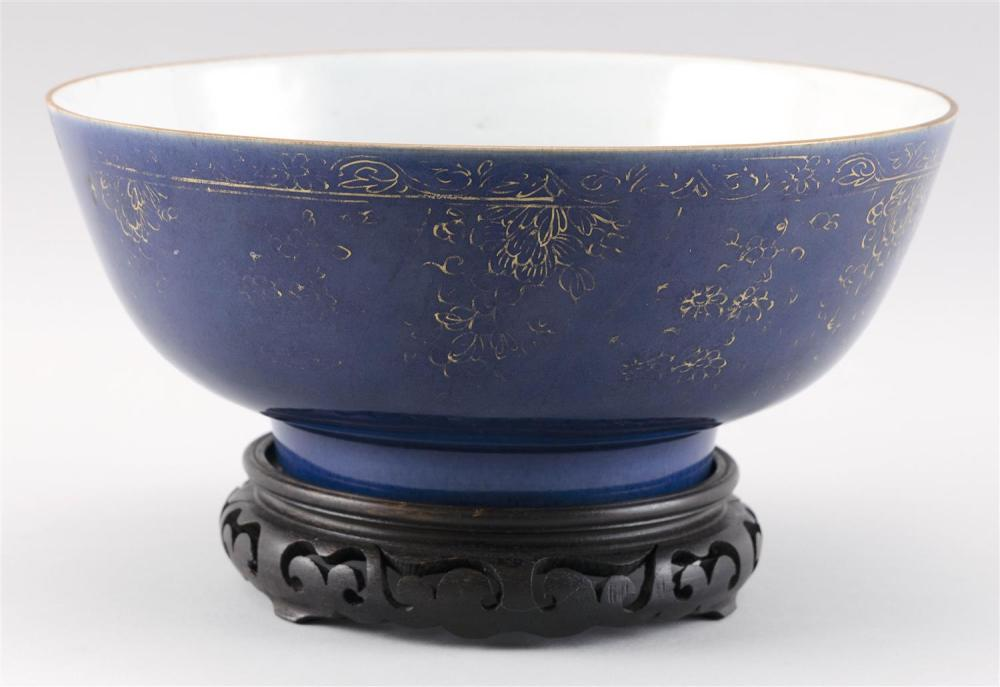 """CHINESE PORCELAIN BOWL Exterior with gilt decoration on a deep blue ground. Interior with orange flowers. Height 4.75"""". Diameter 10...."""
