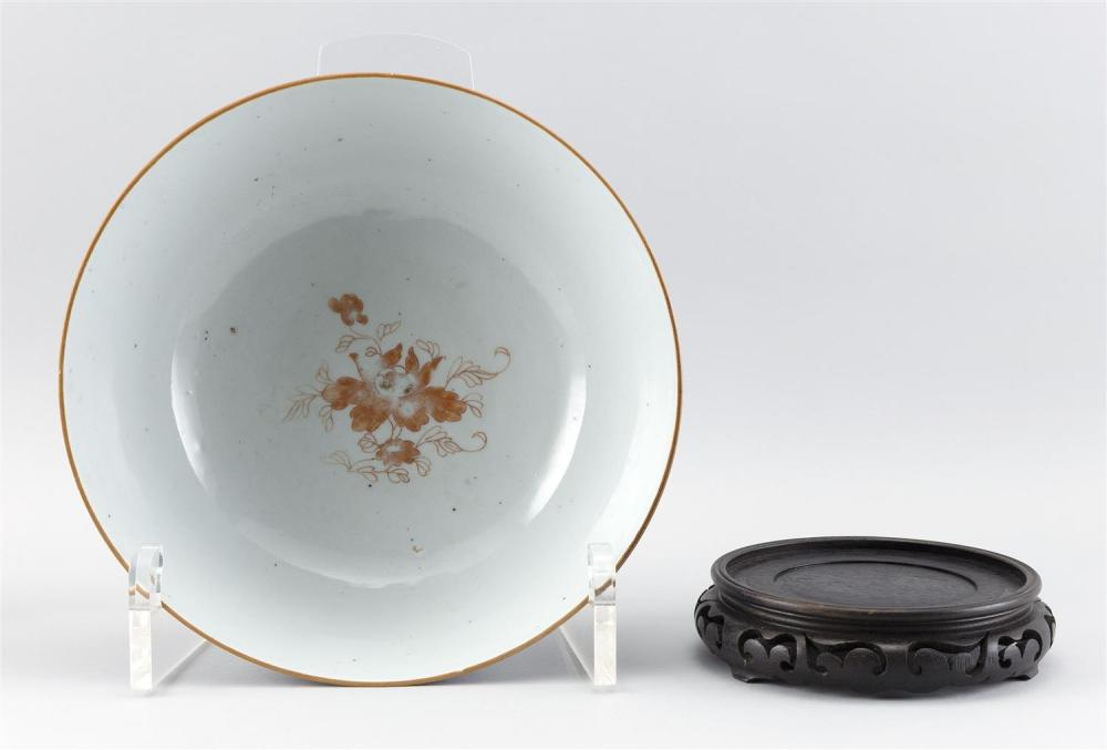 CHINESE PORCELAIN BOWL Exterior with gilt decoration on a deep blue ground. Interior with orange flowers. Height 4.75
