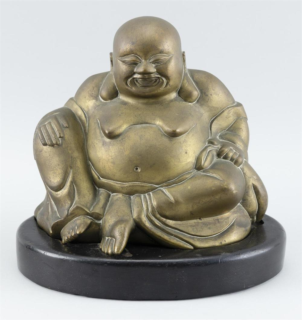 """GILT METAL SCULPTURE OF A SEATED LAUGHING BUDDHA Height 9.5"""". Width 9.5"""". Depth 6.5"""". On a wooden base."""