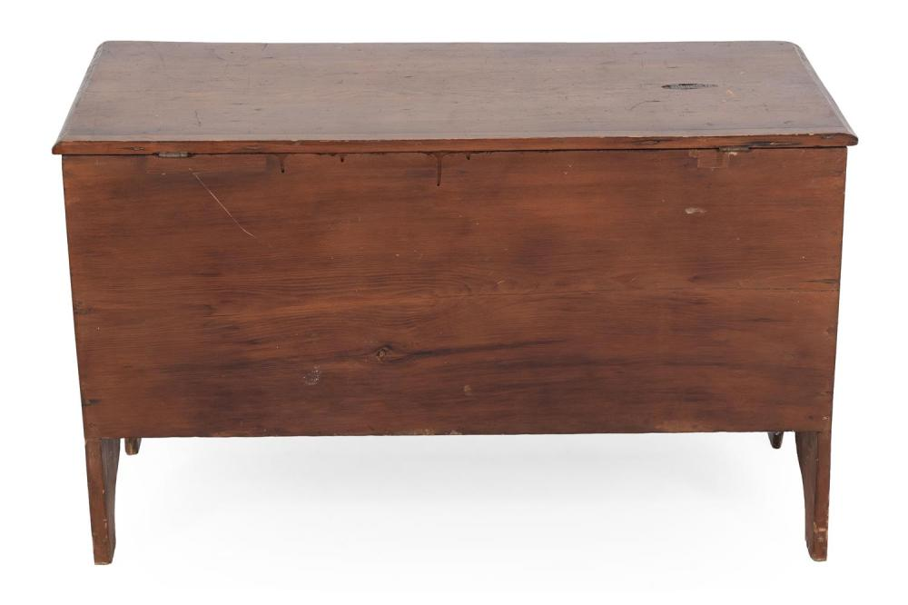LIFT-TOP BLANKET CHEST In pine under a brown stain. Bootjack ends. Height 24.5