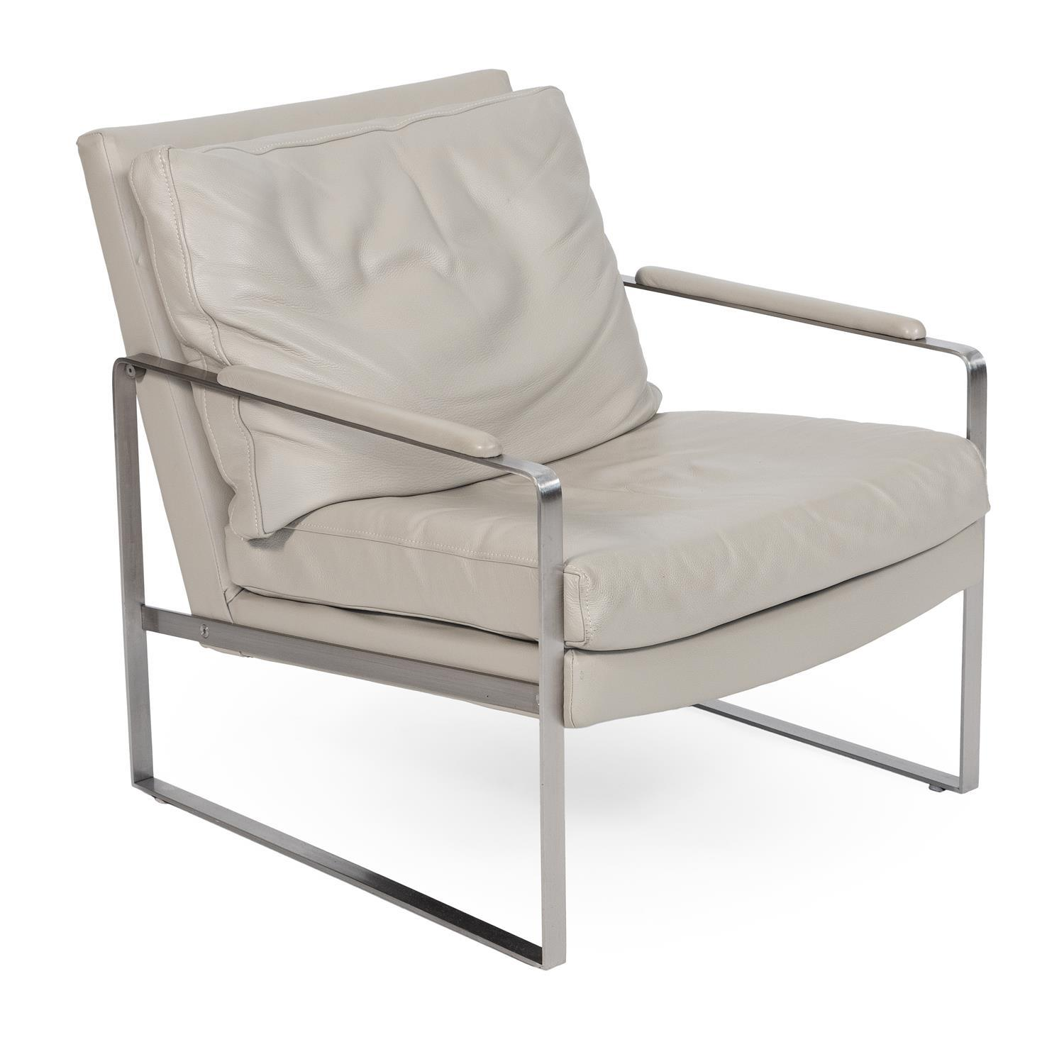 """STAINLESS STEEL ARMCHAIR WITH BEIGE LEATHER UPHOLSTERY Unmarked. Back height 31"""". Seat height 17.5""""."""