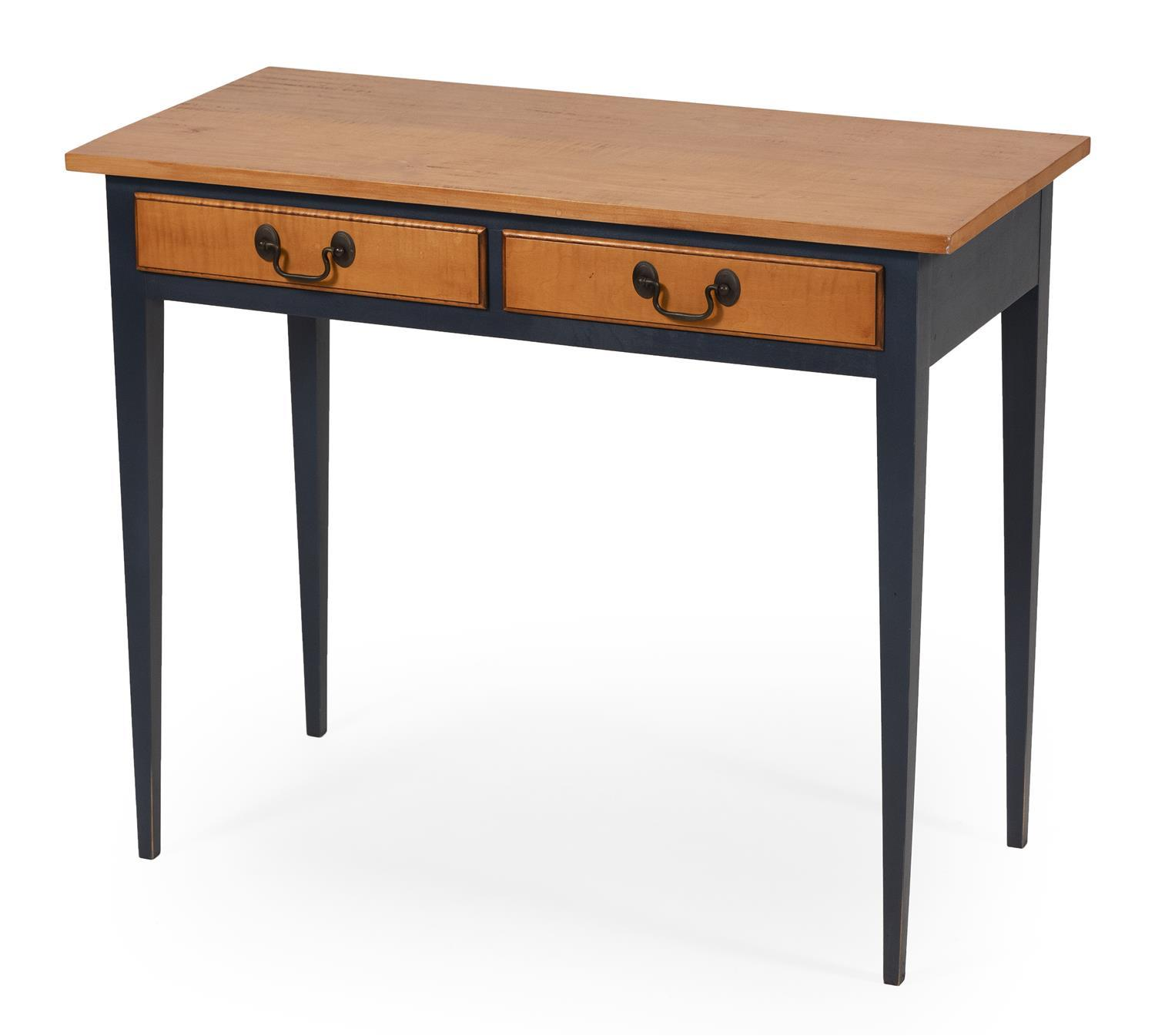 ELDRED WHEELER DIMINUTIVE SERVING TABLE Maple top with traces of tigering. Two half drawers with brass bail handles. Blue-painted ba...