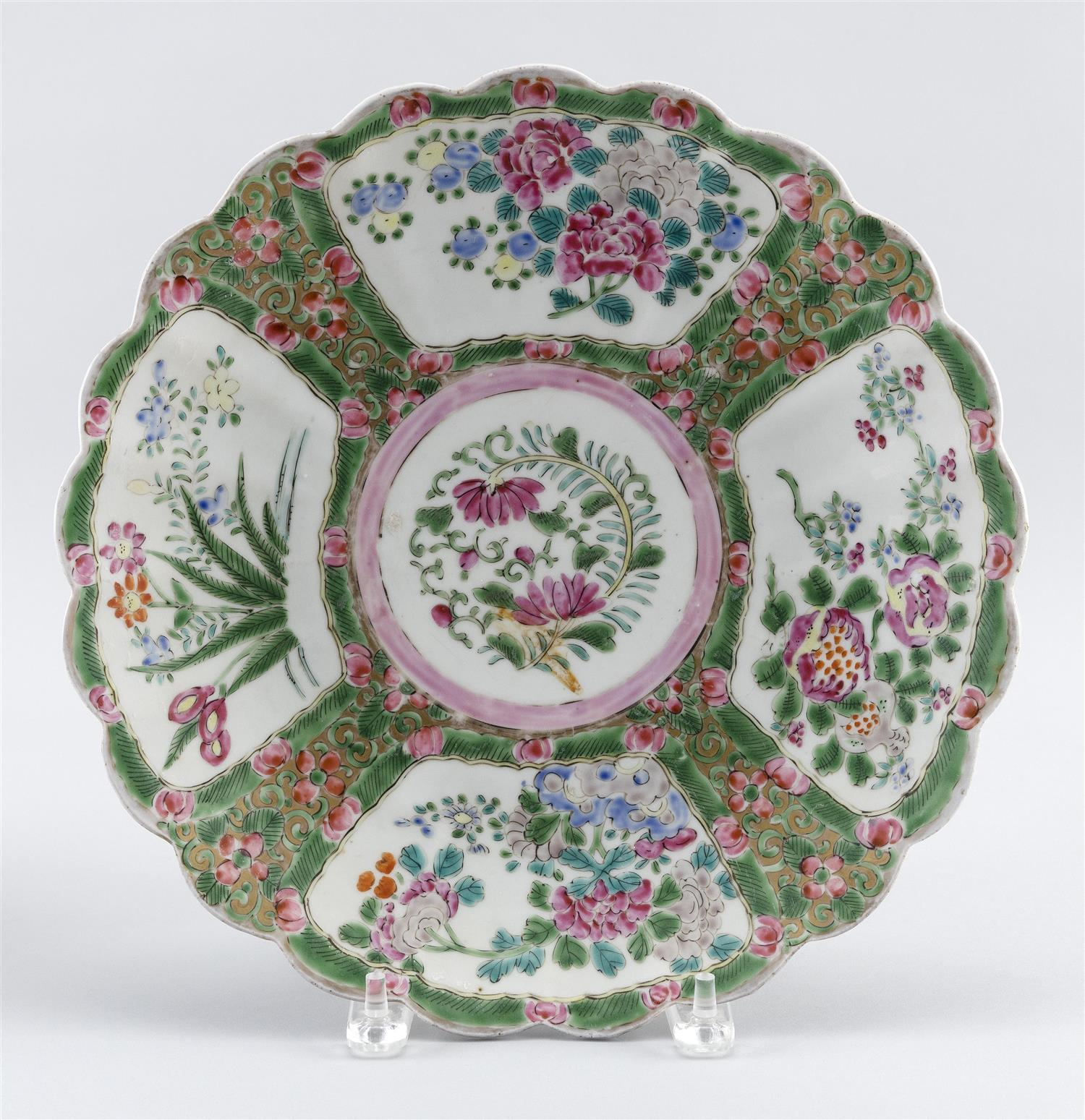"CHINESE PORCELAIN FLORIFORM CHARGER With floral decoration. Six-character mark on base. Diameter 12.5""."