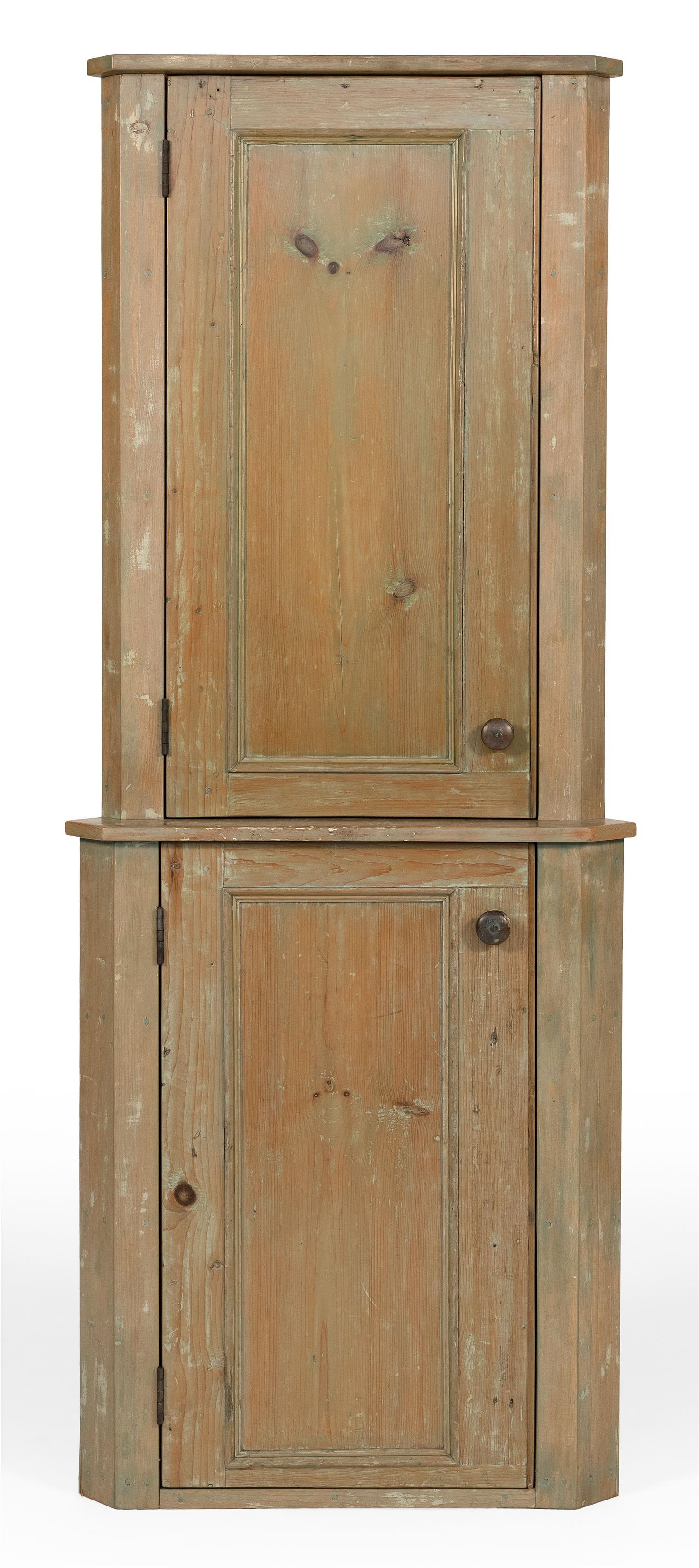WEST BARNSTABLE TABLE COMPANY CORNER CUPBOARD In pine, under remnants of green paint. One-piece construction. Two paneled doors, bot...