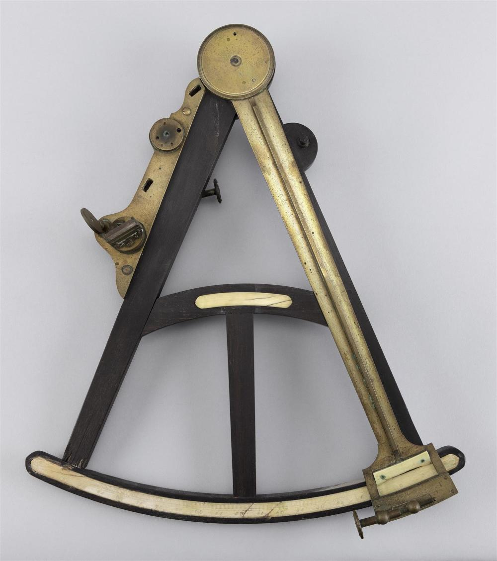 "BRASS, MAHOGANY AND BONE SEXTANT Height 15"". Width 13""."